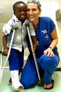 volunteer-nurse-with-young-African-boy